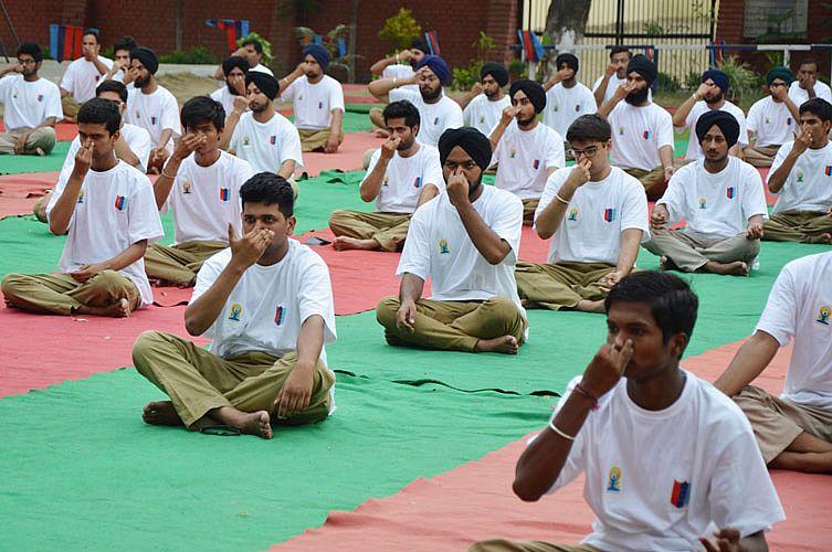 "NCC CADETS PERFORM YOGA in GADVASU on ""International Yoga Day on 21st June, 2015"