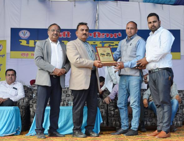 Dr. H. K. Verma, Director of Extension Education awarded the prize for stall exhibition in Pashu Palan Mela (16-03-2019)