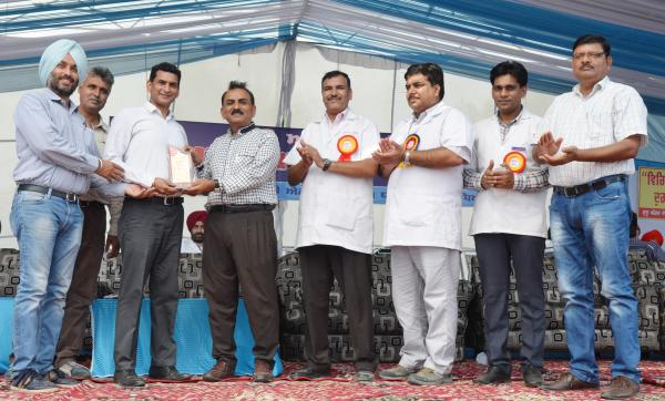 Dr. H. K. Verma, Director of Extension Education awarded the 2nd prize for stall exhibition to School of Animal Biotechnology in Pashu Palan Mela