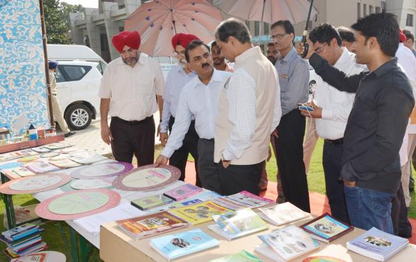 Dr. A. S. Nanda, Vice Chancellor, Dr. H.K.Verma, Director of Externsion Education and other officers brief the exhibit stall  to Dr. Trilochan Mohapatra, DG, ICAR on the visit of University on dated 8-10-2018